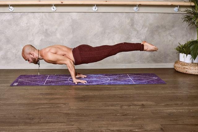 man-standing-on-floor-using-both-hands-1881994