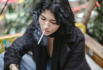photo-of-woman-smoking-cigarette-3916481