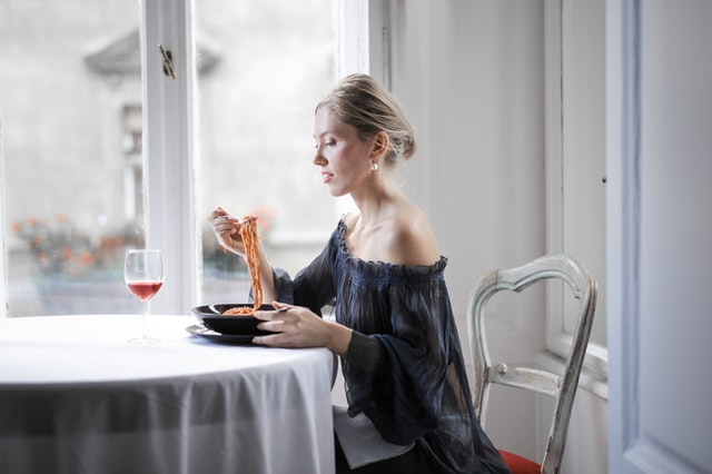 selective-focus-photo-of-woman-in-a-black-off-shoulder-dress-3764489
